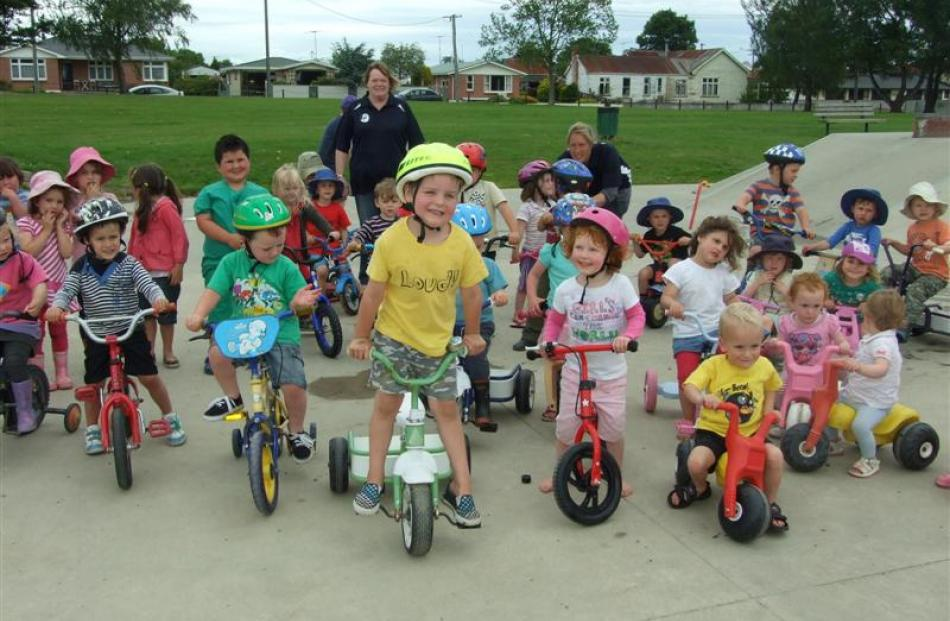 Children, parents, and staff of the Tokomairiro Early Learning Centre celebrate plans for a cycle...