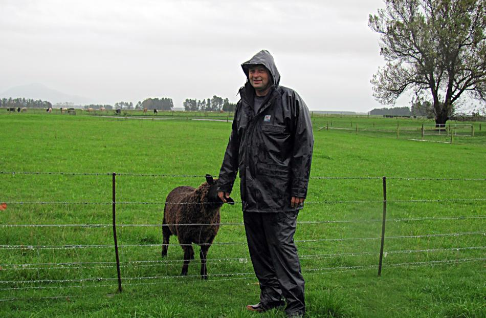 Chris Allen, president of Mid Canterbury Federated Farmers, dons his wet-weather gear  to head...