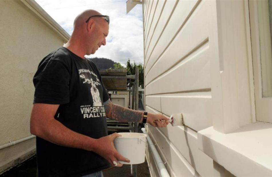 Chris Rhodes paints a student flat owned by Lyndon Clayton in Harbour Tce, Dunedin, yesterday....