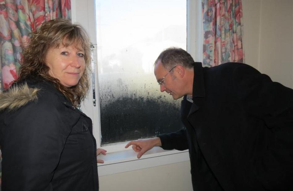 Clare Curran and Phil Twyford take a closer look at  mould on windows in Karyn and Graeme...