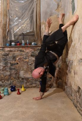 Co-director and dancer Rhys Latton rehearses in the Athenaeum basement yesterday for Dunedin...