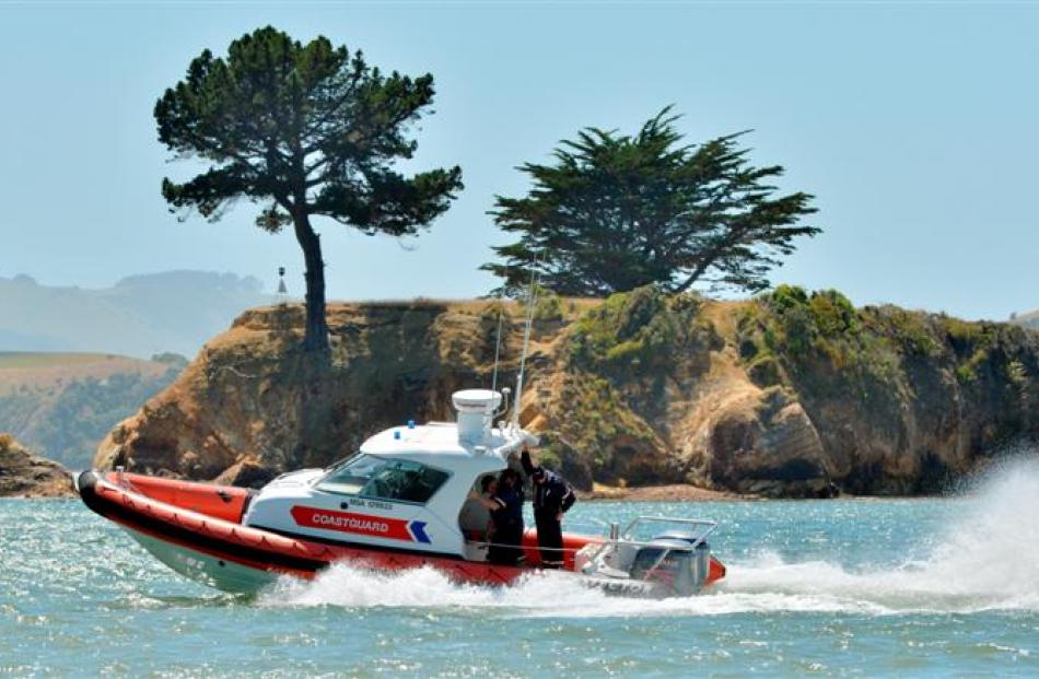 Coastguard Dunedin crew test their new vessel, enjoying the extra horsepower, on Otago Harbour...