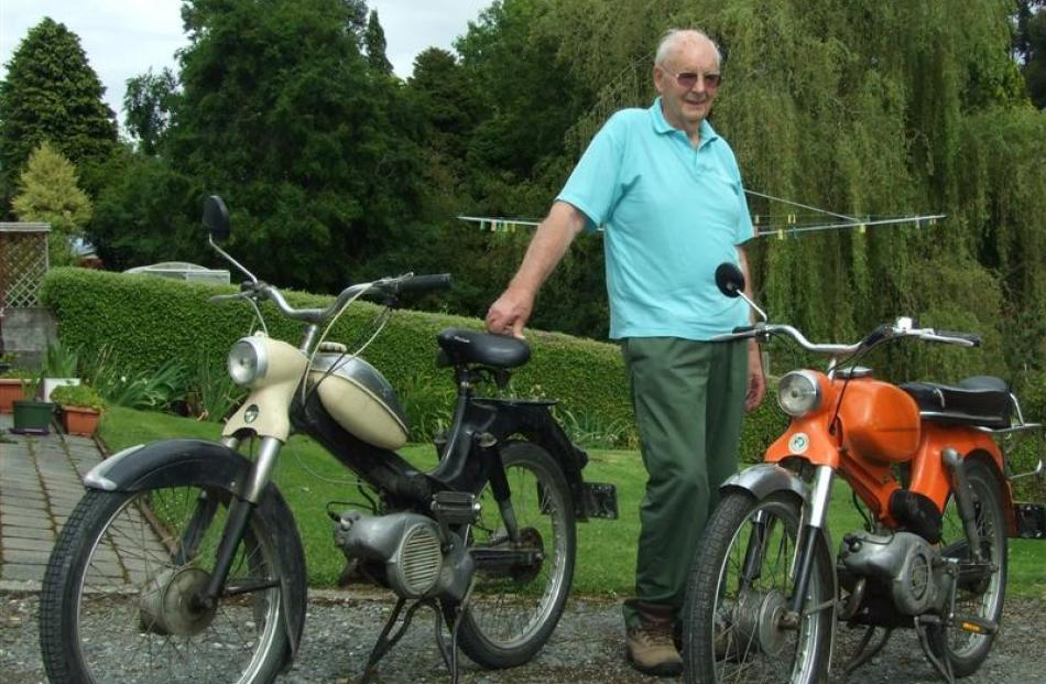 Collector Allan Budge with his two mopeds - a 1958 Puch (left) and a 1974 Puch. Photos by Helena...
