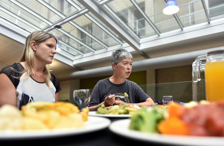 Compass national development and innovation manager Lauren Scott (left) samples the meals with...