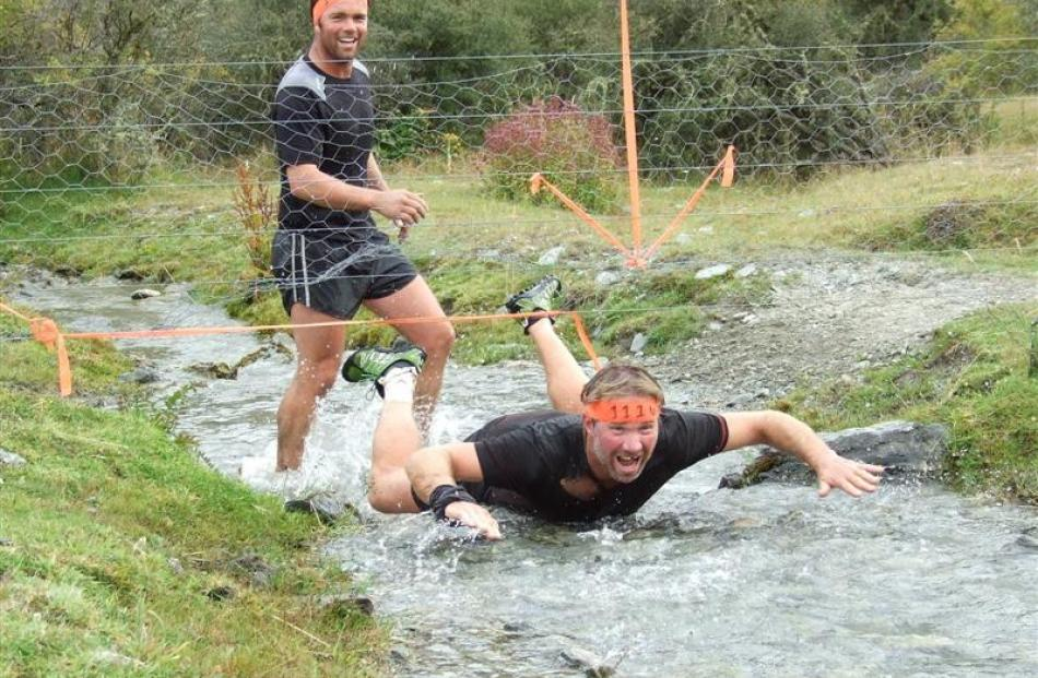 Competitors in The Mule, an assault-style obstacle course race held at Moke Lake at the weekend,...