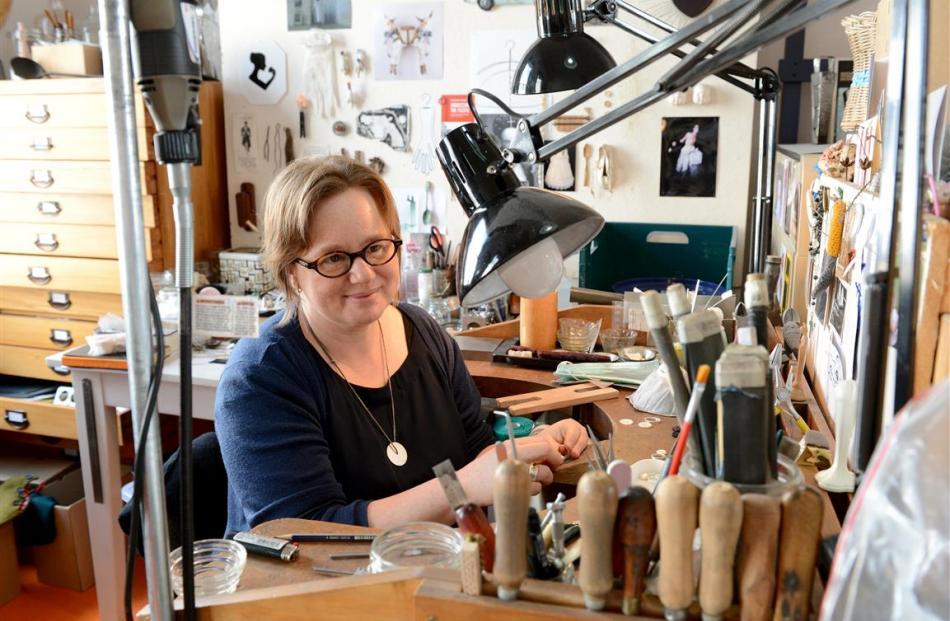 Contemporary jeweller Victoria McIntosh at work in her Stuart St studio. PHOTOS: LINDA ROBERTSON