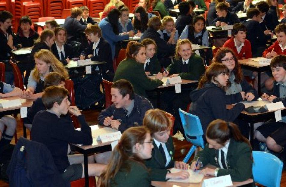 Contestants in the year 9 and 10  Otago Daily Times Extra! spelling quiz ponder a question at...
