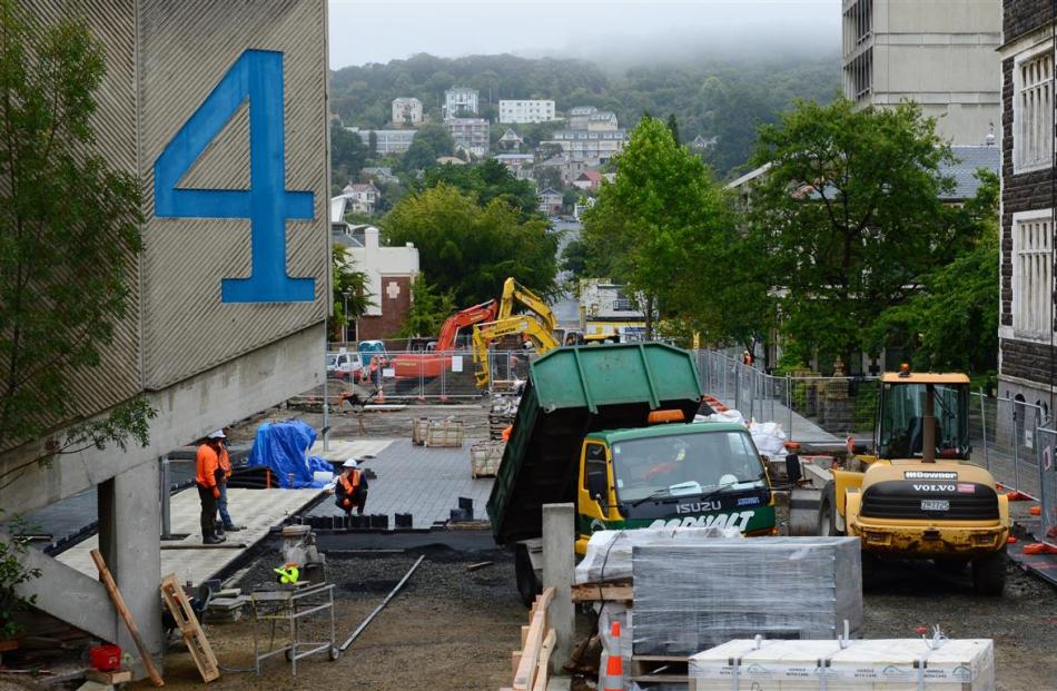 Contractors work on paving at the University of Otago. Photo by Gerard O'Brien.
