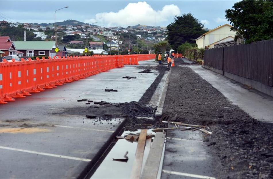 Contractors work on widening the footpath to create a shared path on Tahuna Rd. Photos by Peter...