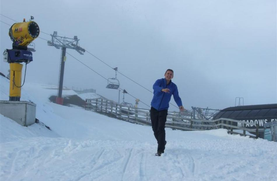 Coronet Peak's ski area manager, Ross Copland, throws snowballs  as opening day looms. Photo by...