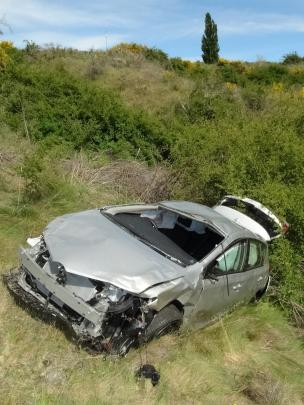 This rental car, driven by an Australian man, crashed down a steep bank below the Gibbston...