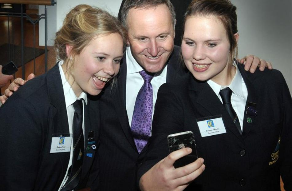 Cromwell College pupils Rachel Clark (left) and Jacinda Morton (right) have their photo taken...