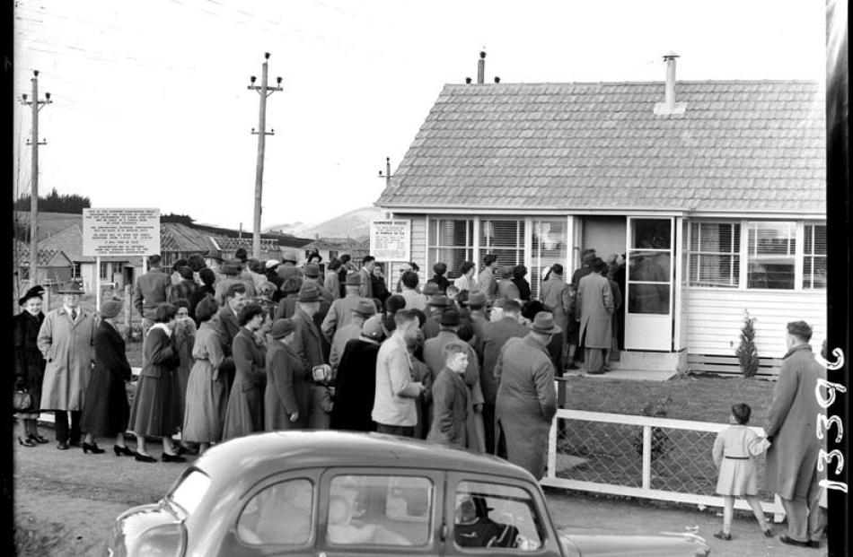Crowds flock to inspect  a government ''Hammond'' house in Halfway Bush, part of a 1950s...