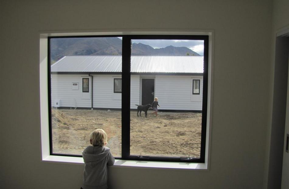 Cruz Schryvers looks out on his new front yard. Photos by Mark Price
