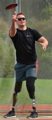Curtis McGrath, who lost both his legs on army duty in Afghanistan, practises his discus throw at...