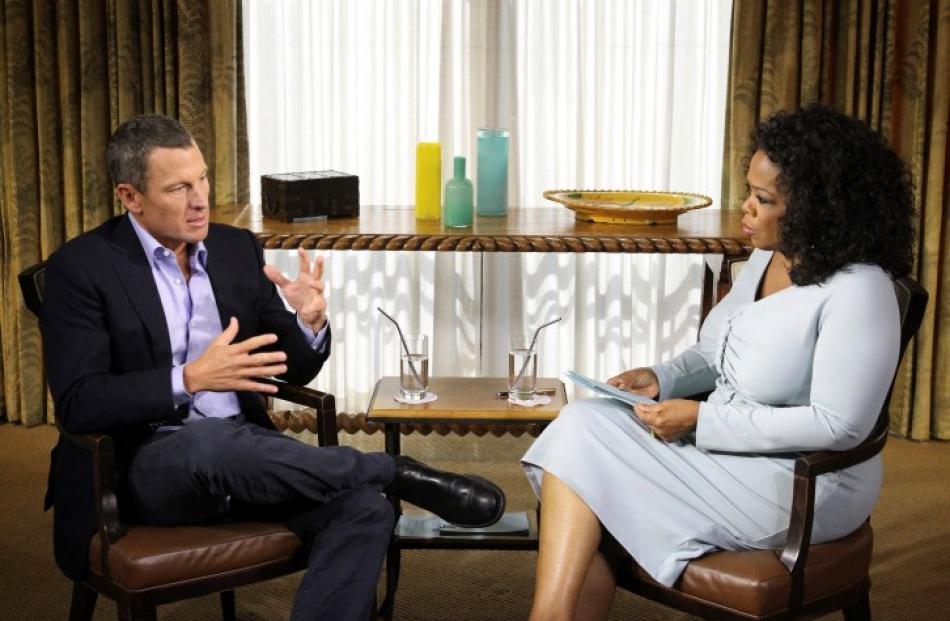 Cyclist Lance Armstrong is interviewed by Oprah Winfrey in Austin, Texas in theis handout photo...