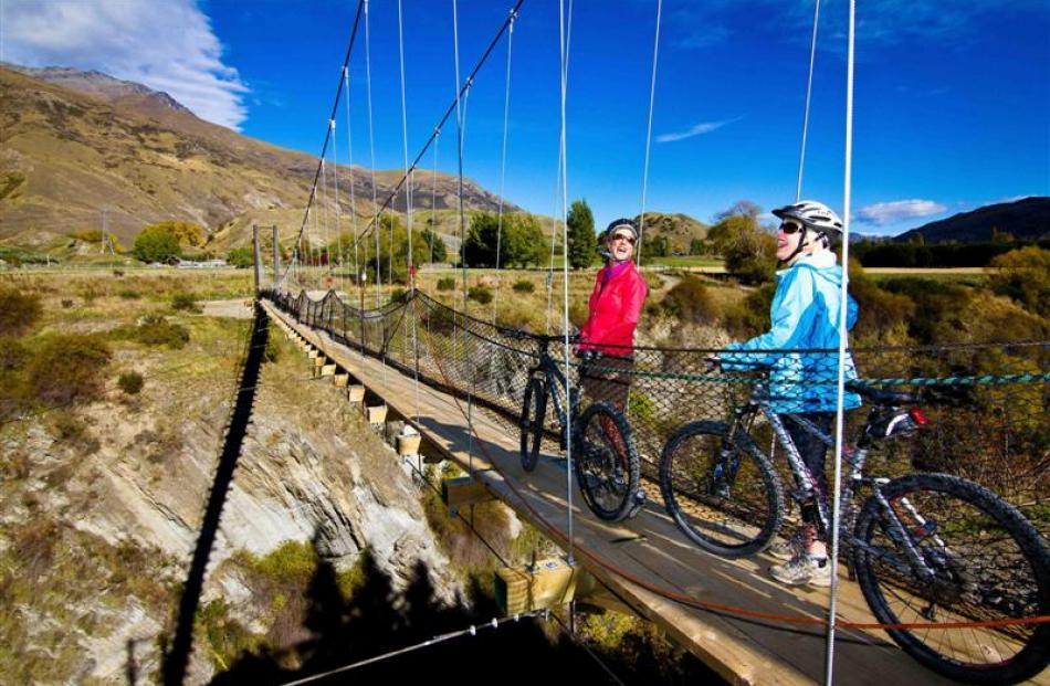 Cyclists admire the view from The Edgar Bridge on  the Queenstown Trail.  Concerns have been...