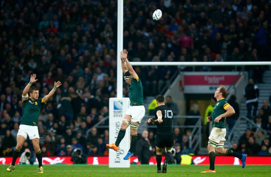 Dan Carter kicks a drop goal in the All Blacks Rugby World Cup semifinal against South Africa....