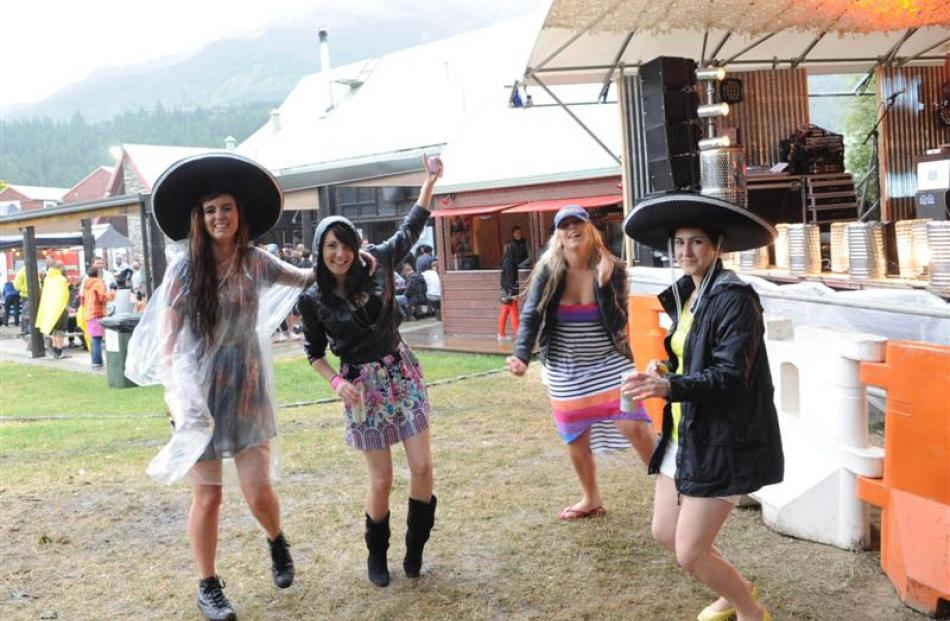 Dancing in the rain as Samsam play at the Summerlands 2013 concert at Lake Hawea Hotel yesterday ...