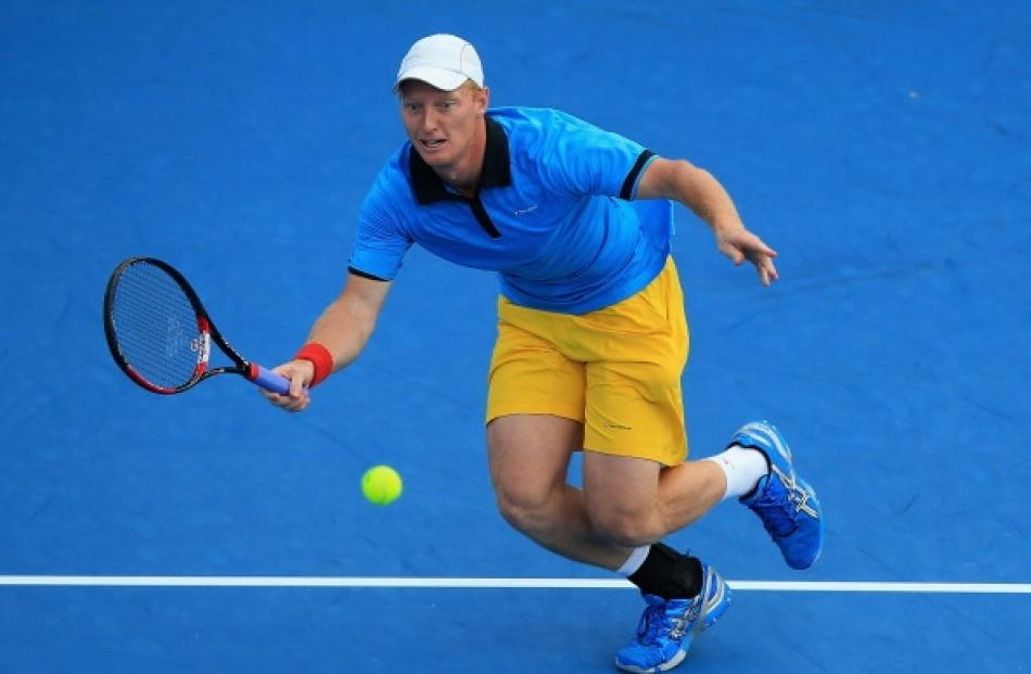 Daniel King-Turner of New Zealand plays a forehand in his first round match against Jesse Levine...