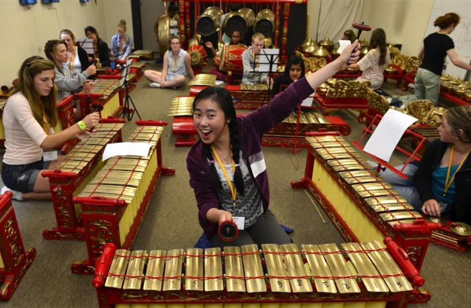 Darina Khun (17), of Wellington, takes part in a gamelan music performance at the University of...