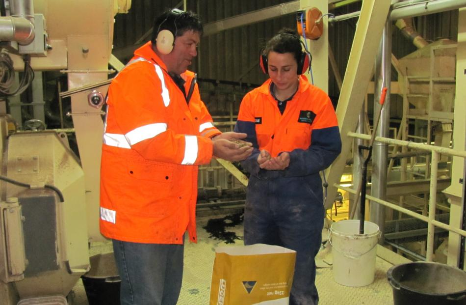 Darryn McDonnell, operations manager of Seales Winslow's Ashburton plant, inspects product with...