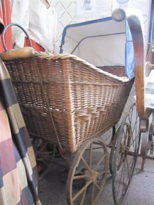 Dating from the early 1800s, this cane pram with wooden wheels is the oldest in the museum.