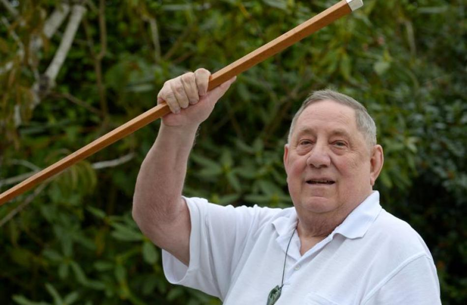 David Ellison holds a walking cane which was given to his grandfather John Matapura Ellison in...