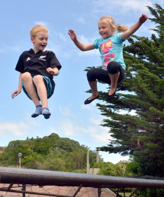 Deakin (7) and Jordin (5) Eckhoff enjoy a bounce on the Dunedin Hoiliday park trampoline...