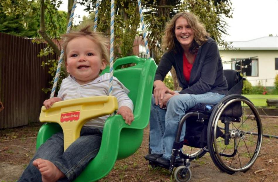 Debbie Henderson, who broke her back in a horse-racing accident, and 10-month-old son Will at...