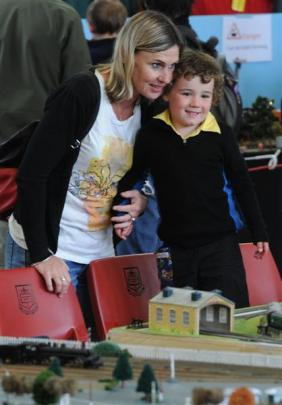 Debra King and Felix Newell (3), of Dunedin, watch the little trains. Photos by Craig Baxter.