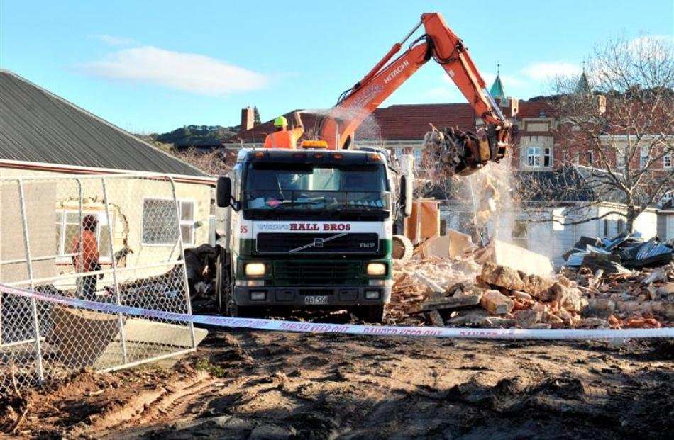 Demolition work continues in Montgomery Ave, Dunedin, for a University of Otago child-care centre...