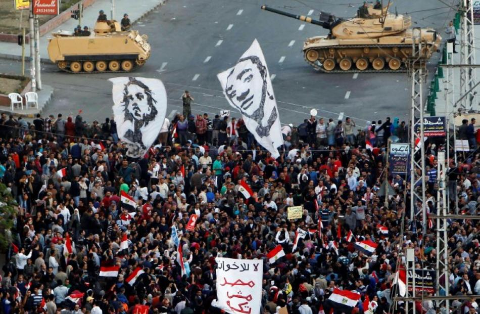 Demonstrators stage a protest outside the presidential palace in Cairo. REUTERS/Mohamed Abd El Ghany