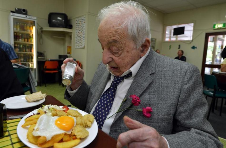 Dick Reid celebrates his 100th birthday by tucking into a meal which included six oysters, at the...