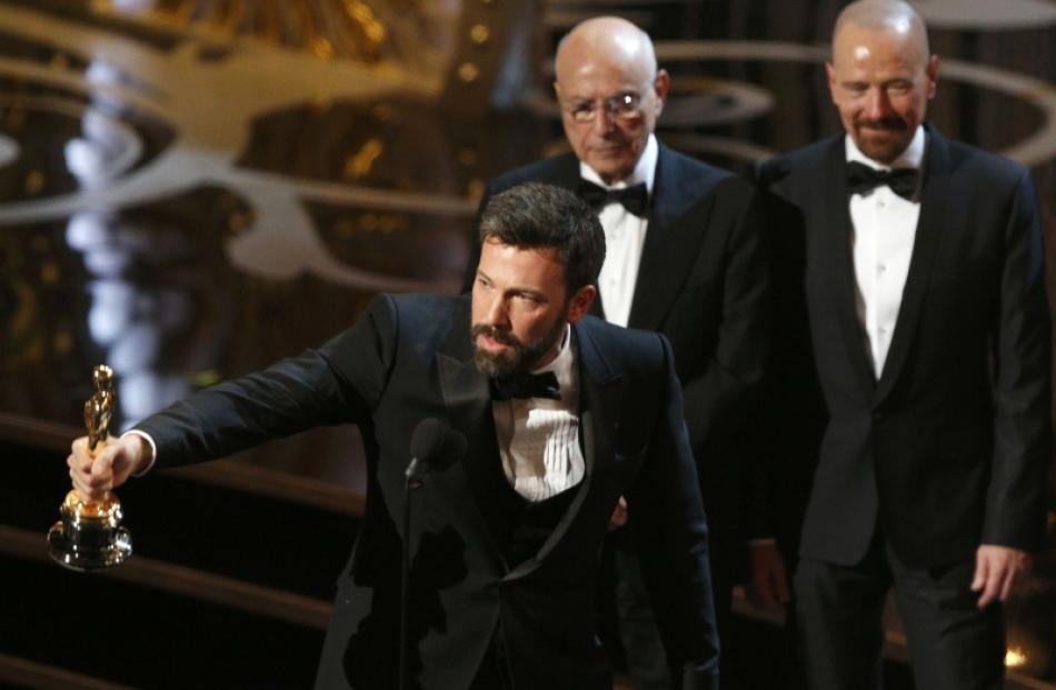 Director and producer Ben Affleck accepts the award for best motion picture for 'Argo' as actors...