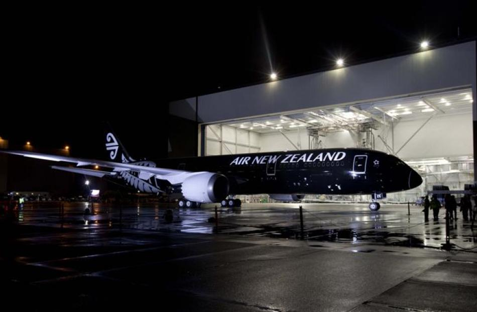 Air New Zealand's 787-9 Dreamliner rolls out of the paint hangar to reveal its paint-job for the...