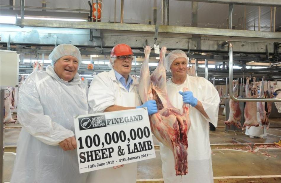 Displaying the 100 millionth kill in January, 2011, are (from left) farmer Peter McCrostie,...