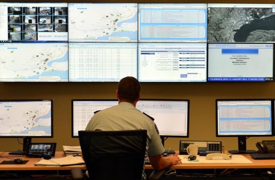 District Command Centre deployment co-ordinator Senior Sergeant Craig Brown keeps an eye on what...