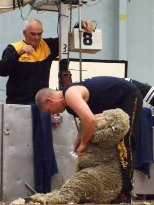 Don Boyle keeps a close eye on his son Damien's efforts as the Western Australian shearer wins...