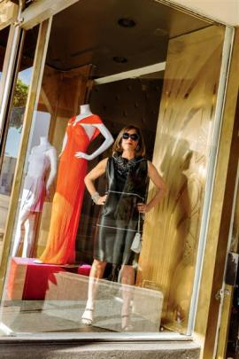 Doris Raymond in the front window of The Way We Wore.