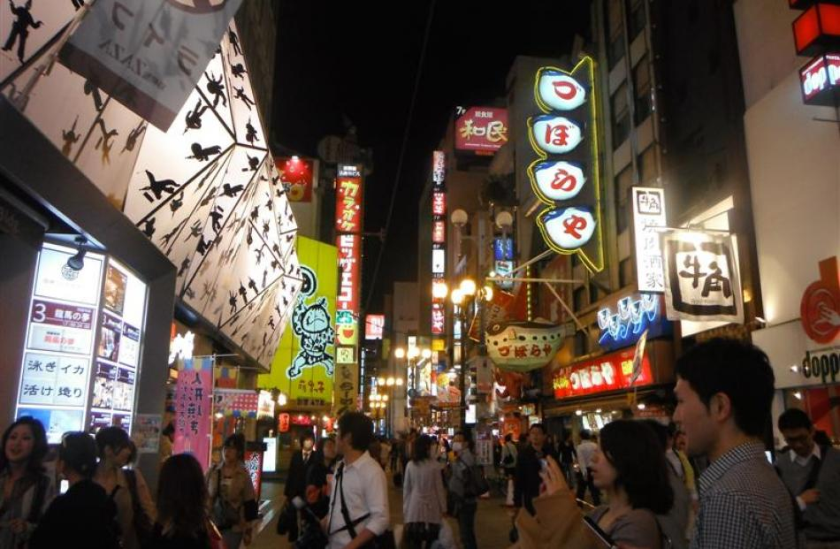 Dotonbori, a long, narrow street containing a high concentration of restaurants.It is rough-and...