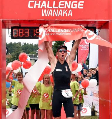Dougal Allan, of Wanaka, crosses the finish line to claim first place.