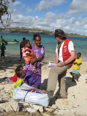 Douglas Clark distributes aid in Vanuatu following Cyclone Pam. Photos supplied.