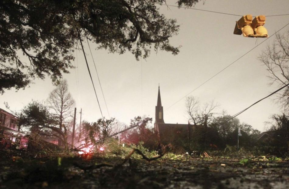 Downed trees and power lines along with a damaged traffic light caused by a Christmas Day tornado...