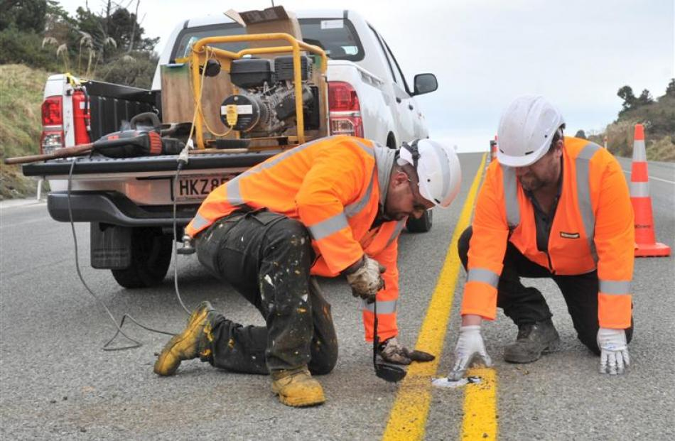 Downer line marking technician Anthony McKenzie and hybrid maintenance supervisor Shane Wilde...