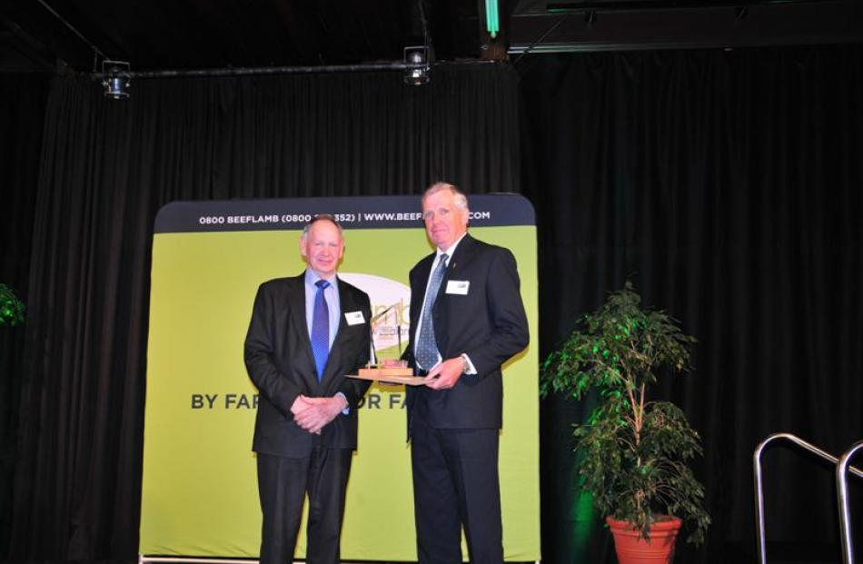 Dr George Davis (right) receives the Silver Fern Farms sheep industry science award from Silver...