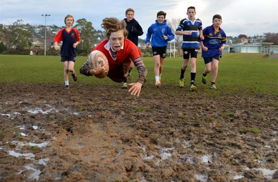 Drew Cairney (13, front) trains with his Kaikorai Demons under-13 team-mates (from left) Jevon...