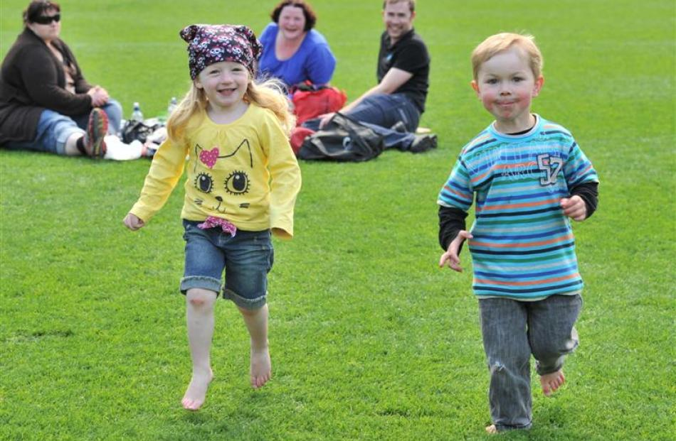 Dunedin 3-year-olds Erika Reilly and Martin Warriner race across the  Forsyth Barr Stadium pitch,...
