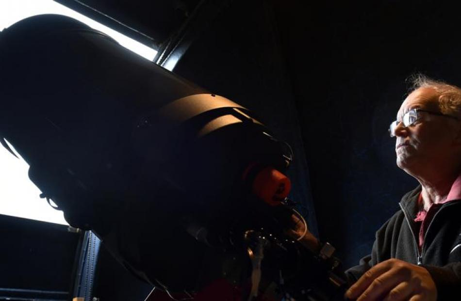 Dunedin amateur astronomer Ash Pennell looks at a 35cm telescope at the Beverly-Begg Observatory...