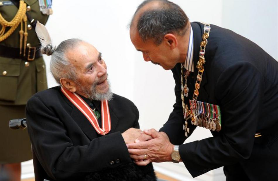 Dunedin artist Ralph Hotere is congratulated by New Zealand Governor-General Sir Jerry Mateparae...